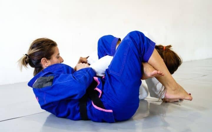 omoplata two women doing jiu jitsu legacy