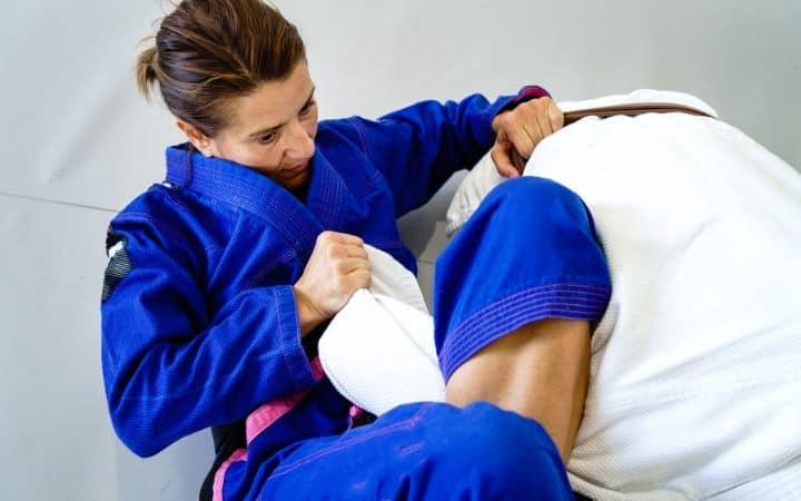 omoplata two women practicing brazilian jiu jitsu