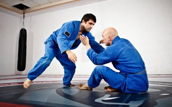 Two men in BJJ training preparing for straight arm bar | Jiu Jitsu Legacy