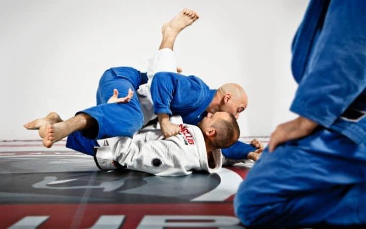 Two men sparring in BJJ training | Jiu Jitsu Legacy