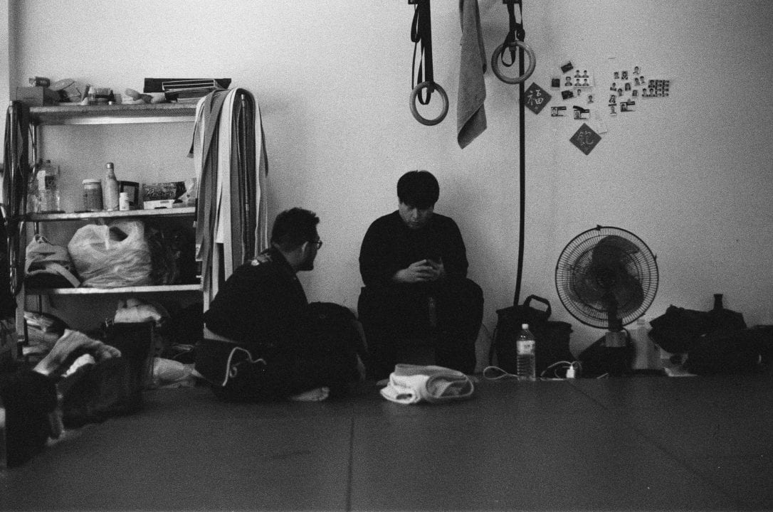 Two jiu jitsu athletes resting