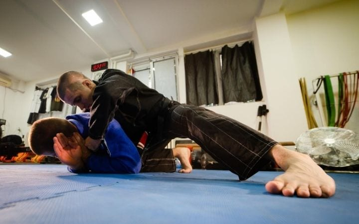BJJ sparing and attacking from turtle position going for a choke, Crucifix Position in BJJ | Jiu Jitsu Legacy