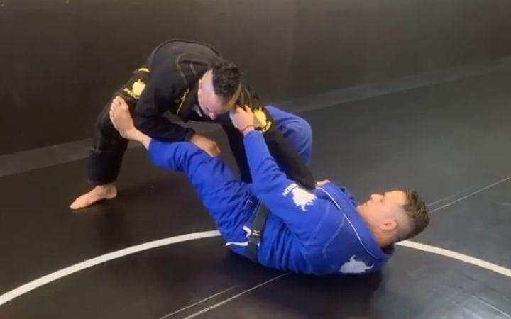 Two men demonstrating Gi choke from sweep | Jiu Jitsu Legacy