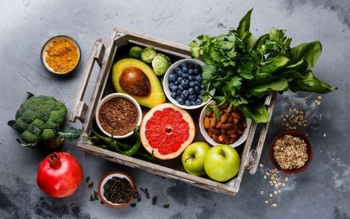 Veggies, fruits, almonds and flax seeds in the wooden box | Jiu Jitsu Legacy