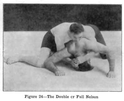 A full nelson hold positions both of the hands behind the head, unlike a half nelson  hold in which the head is only controlled by a single hand. In this picture a wrestler demonstrates a full nelson on a his opponent who is in referee/turtle position
